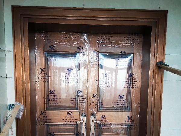 佛山铜门厂家爱唯铜艺——顺德胡总别墅铜门简约风格